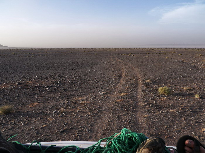 Going through stony desert on the roof of the car